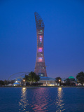 Qatar, Doha,  the Torch Hotel Reflecting in the Lake in Aspire Park Photographic Print by Jane Sweeney