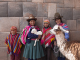 South America, Peru, Cusco. Quechua People in Front of An Inca Wall, Holding a Lamb and a Llama Fotografisk tryk af Alex Robinson