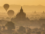 Pagodas and Temples of the Ancient Ruined City of Bagan, and Balloons at Sunrise, Myanmar Photographic Print by Peter Adams