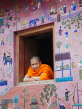 Monk at Window of the Reclining Buddha Sanctuary Aka the Red Chapel, Laos Photographic Print by Steve Vidler