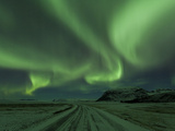 Northern Lights, Aurora Borealis, Winter Road With Snow, Iceland Photographic Print by Peter Adams