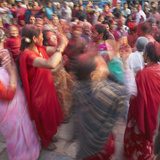Nepalese Women Celebrating Holi Festival, Bhaktapur, Kathmandu Valley, Nepal Photographic Print by Ian Trower