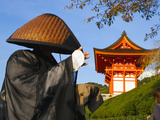 Japan, Honshu, Kansai Region, Kiyomizu-Dera, Shinto Priest Seeking Donations Wearing a Bamboo Hat Photographic Print by Gavin Hellier