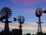 USA, Oklahoma, Elk City, Vintage Farm Windmills Photographic Print by Walter Bibikow
