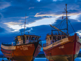 Chile, Magallanes Region, Puerto Natales, Seno Ultima Esperanza Bay, Fishing Boats, Dusk Photographic Print by Walter Bibikow