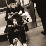 Woman Reading on a Subway with a Marilyn Monroe Purse and an 'I Love New York' Bag, 2004 Photographic Print by Stephen Spiller
