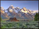 An Old Mormon Barn Sits at the Base of Grand Teton Framed Canvas Print by Robbie George