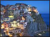 Dusk Falls on a Hillside Town Overlooking the Mediterranean Sea, Manarola, Cinque Terre, Italy Framed Canvas Print by Dennis Flaherty
