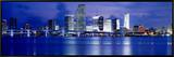 Panoramic View of an Urban Skyline at Night, Miami, Florida, USA Framed Canvas Print by Paula Scaletta