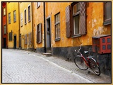 Street Scene in Gamla Stan Section with Bicycle and Mailbox, Stockholm, Sweden Framed Canvas Print by Nancy & Steve Ross
