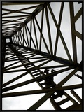 A Reenactor is Silhouetted Inside a Replica of the Spindletop Oil Derrick Framed Canvas Print