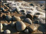 Water Washes up on Smooth Stones Lining a Beach Framed Canvas Print by Michael S. Lewis