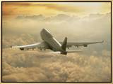 Jumbo Jet Above Clouds at 35,000 Feet Framed Canvas Print by Peter Walton