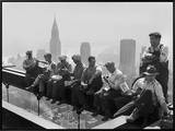 Construction Workers Take a Lunch Break on a Steel Beam Atop the RCA Building at Rockefeller Center Framed Canvas Print