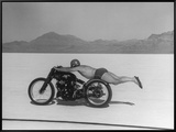 Roland Free Breaking World's Speed Record on Bonneville Salt Flats While Laying on His Bike Framed Canvas Print by Peter Stackpole