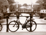 Bike on Bridge and Canal, Amsterdam, Holland Metal Print by Jon Arnold