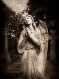 Statue of a Female Angel Praying in Cemetery Metal Print by Clive Nolan