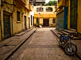 Back Street of Luxor Town, Egypt with Motorbike Metal Print by Clive Nolan