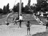 Children Playing at a Playground, 1936 Metal Print by  Scherl