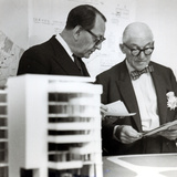 Charles Edouard Jeanneret, known as Le Corbusier (1887-1965) Discussing Architectural Plans, c.1949 Photographic Print by  French Photographer