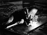 A Welder at Work in Yarrow's Shipyard, 1955 Photographic Print