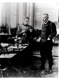 Pierre (1859-1906) and Marie Curie (1867-1934) in their Laboratory, c.1900 Photographic Print by Valerian Gribayedoff
