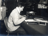 Apsley Cherry-Garrard (1886-1959) with His Typewriter on Board 'Terra Nova' British Antarctic… Photographic Print by Herbert Ponting