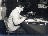 Apsley Cherry-Garrard (1886-1959) with His Typewriter on Board 'Terra Nova' British Antarctic… Photographic Print by Herbert Ponting
