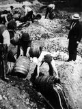 A Us Federal Agent Oversees the Destruction of Beer Kegs During the American Prohibition Era… Photographic Print by  American Photographer