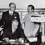 Stalin Pats Ribbentrop on the Back, While Molotov Scans the Signed Pact Which Partitioned Poland,… Photographic Print by  English Photographer