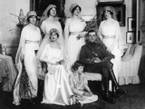 Bride and Bridegroom with Bridesmaids and Train Bearers Reproduction photographique par  English Photographer