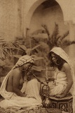 Harem Girls Smoking a Hookah, from an Early 20th Century Postcard Photographic Print