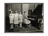 Woman Playing the Piano While Three Girls Sing at the New York Association  Giclee Print by  Byron Company