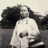 Kenyah, or Kayan Woman with Long Earlobes Visiting the Town of Kuching in the 1940s Photographic Print