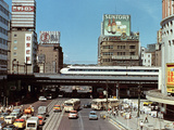 Japanese Express Train Passing Through the Yuraku-Cho Area in the Ginza, Tokyo Photographic Print by  Japanese Photographer