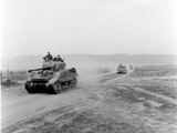 Tanks on the Move to Vire over the Tank Runs, c.1945 Impressão fotográfica por  English Photographer