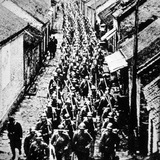 Japanese Troops March Through a Town in Manchuria, 1932 Photographic Print by  Japanese Photographer
