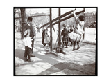 View of a Man Overseeing Children Playing on Playground Equipment at Tompkins Square Park, on… Giclee Print by  Byron Company