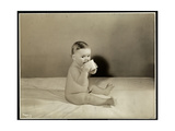 A Baby Sitting Up in Bed Drinking from a Cup at the Maternity Center Association at 70th Street… Giclee Print by  Byron Company
