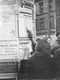East Berliners Checking the Location of Currency Exchange Points in Berlin-Mitte for the… Photographic Print by  German photographer