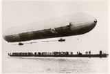 The First Flight of the Prototype Airship Zeppelin LZ1, Shown Above a Boat on Lake Constance,… Photographic Print by  German photographer