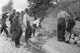 Soldiers of the Territorial Army Making Soup at a Camp on Pont de l'Alma, Paris, 1914 Photographic Print by Jacques Moreau