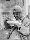Soldier Eating Soup, 1915 Photographic Print by Jacques Moreau