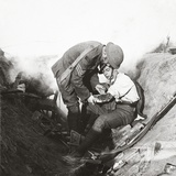 Receiving First Aid from His Sergeant in a Sap During the Height of Battle at Peronne, 1918 Photographic Print by  English Photographer