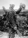 British Soldier with Bandaged Head Shows the Steel Helmet That Saved His Li Photographic Print by  English Photographer