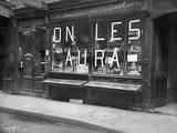 'We'll Get Them' Written on Paper Strips Stuck on an Herbalist's Window Shop, Paris, 1918 Photographic Print by Jacques Moreau