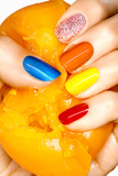 Yellow Tomato and Multi Colored Nails Photographic Print by Arthur Belebeau