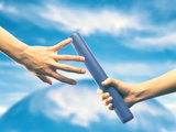 Human Hand Passing Relay Baton Photographic Print by Green Light Collection