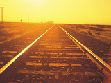 Distance View of Rail Track at Dawn Photographic Print by Green Light Collection