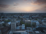 Buildings in a City at Dawn, Riga, Latvia Photographic Print by Green Light Collection